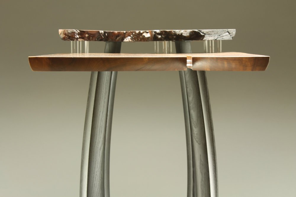 close up side view of table, is 29″ x 37″ x 16″ materials: redwood burl, reclaimed ebonized mulberry