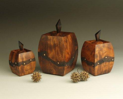 "Triptych boxes, 4 ¼"" x 2 ¾"" x 2 ¾"", 5 ½"" x 3 ⅜"" x 3 ⅜"", 6 ¾"" x 4 ⅛"" x 4 ⅛"" materials: redwood burl, rosewood"