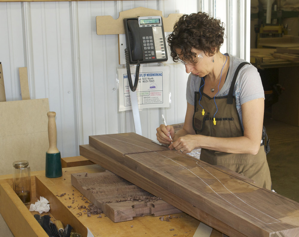 kelly parker measuring a piece of wood