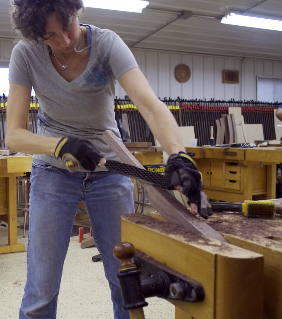 kelly parker working with a oiece of wood.