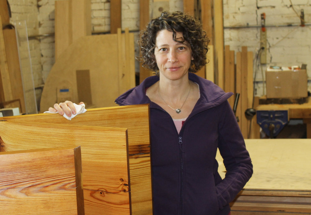 kelly parker with wood in her studio